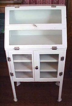 Medical Cabinet Antique Free Standing Metal Legs.....Small size, fits great into a bathroom for towels etc. (Sold)