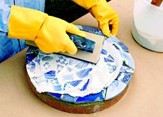 Spread grout, filling gaps.