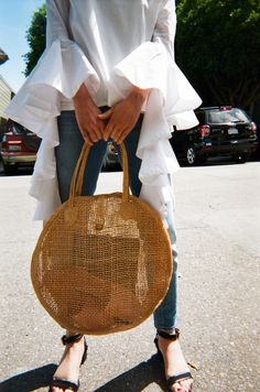 Say hello to perfect summer bag! Take this straw tote to the beach, farmers market, to brunch and beyond. This circle woven straw round tote is in excellent condition. Handmade A-Renee Creations. Made in the Philippines Only 1 in stock!Approximately 16.25 inch diameter, 4 inch depth, and 9 inch strap drop.Questions about this product? Email hello@lisasaysgah.com, call us 415.757.0995 or DM us on Instagram. We're here for you!