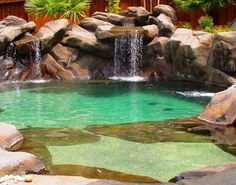 Beach entrance pool with waterfall. Love the color. Beach Entry Pool, Beach Pool, Natural Swimming Pools, Natural Pools, Dream Pools, Swimming Pool Designs, Cool Pools, Pool Landscaping, Water Features