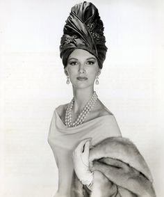 """Betsy Pickering is wearing a silk and jewelled turban called 'Romantico' from Mr. John's """"Goya"""" collection for autumn and winter, 1963"""