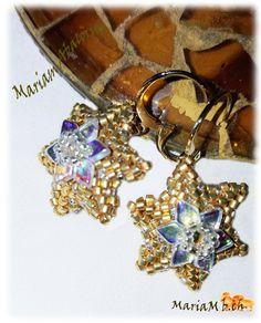 Pendientes estrella con delicas y flor con dragon. diseño de Ana Maria Sanz Rus.