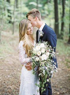 Charis & Ryan's wedding is a DIYer's dream. A private woodland ceremony complete with a Stella York gown from Essense Of Australia and intimate details like tables handcrafted from reclaimed wood barn wood, to the arbor where the Bride's dad married them,