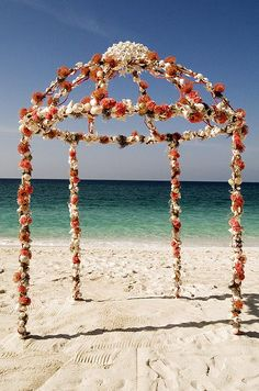 The open sides of the arbor allow the bride and groom to be surrounded by the location's natural beauty. #DestinationWedding #Beach