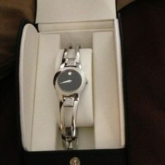 Woman's Movado watch with Diamonds In Box Authentic Beautiful women's Movado watch. Great condition. Accessories Watches