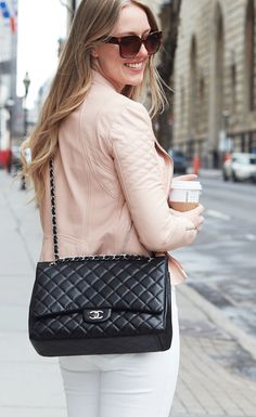 Click to shop this stunning pre-owned Chanel Black Maxi Flap bag.