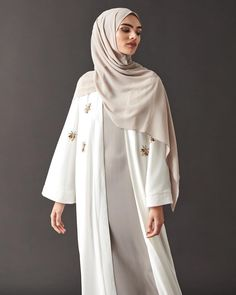 Discover modern elegance in our Ivory Beaded Wrap Kimono. Teamed with our Grey High Neck Abaya and Dove Soft Crepe Hijab. www.inayah.co