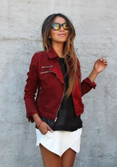 red biker jacket, sheer black top and origami skirt