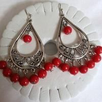 """these are a pair of peacock style earrings with red porecline beads. earring dangles are of tibetan silver and hooks are of surgical steel non allergin. earrings are about 1"""" & 1/2"""" long - $5.00"""
