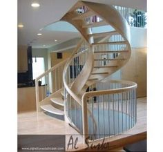 Custom Made Tri-level connected inner stringer fluent hardwood staircase by Signature Staircase Corp.