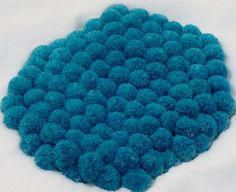 Blue Pom poms rug by LuckLovelyHome on Etsy, $45.00