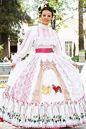 Regional dress-- the dress highlights elements of state craftsmanship like hand embroidery and deshilado, as well as cultural elements such as the grapes from the vineyards and the doorway to the Jardin de San Marcos.