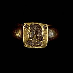 """375-400 AD Roman gold ring with bust of man; 3/4"""" x 1""""; Getty 83.AM.228.4. Per Getty: bust of man engraved on flat square bezel; Roman military attire, but elements typical of eastern Sassanian kingdom: orientation of figure (head one way, body other), hairstyle. Stars both Roman and Sassanian. Man w/o earring unusual for Sassanian. Blend suggests on edges of Empire. Perhaps commission to Sassanian artist by Roman military official?"""