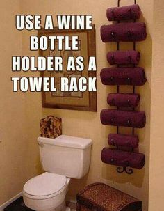 Use a wine bottle holder as a towel rack