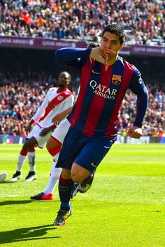 Luis Suarez of FC Barcelona celebrates after scoring the opening goal during the La Liga match between FC Barcelona and Rayo Vallecano de Madrid at Camp Nou on March 8, 2015 in Barcelona, Catalonia.