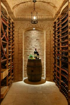 101 Ceiling Design Ideas (Pictures) A small, but beautiful wine cellar in light brick. Wooden racks line both sides of the narrow room. A wine barrel serves as a tasting table. Designed by www. Cave A Vin Design, Wine Cellar Basement, Wine Tasting Room, Tasting Table, Home Wine Cellars, Deco Restaurant, Restaurant Interiors, Light Brick, Wine Cellar Design