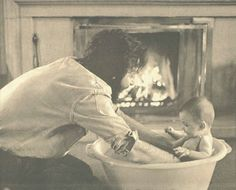 Paul giving one of his daughters a bath