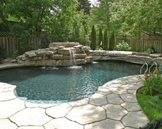 Poolscape with limestone rock formation with multiple water features. The elevated area on the far side of the pool provides visual interest while creating a sense of privacy and enclosure. Inspired by nature, the pool i Concrete Deck, Stamped Concrete, Outside Living, Outdoor Living, Living Pool, Pool Picture, My Pool, The Far Side, Backyard Retreat