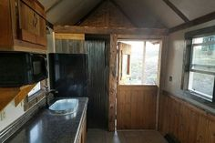 The kitchenette comes with a ¾ fridge, washtub sink, microwave and maybe enough counter space for a cooktop if you want one.  #TinyHouseforUs