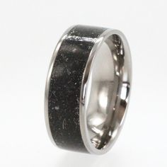 Meteorite Composition Ring / Star Dust inlaid in a Titanium Ring. $276.00, via Etsy.