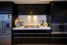 Brodie & Niki Retallick's modern black kitchen with white subway tiles splashback in herringbone pattern. #splashback #blackkitchen #herringbone #house #interiordesign #kitchen #brodieretallick #generationhomes