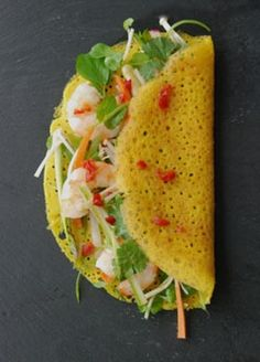 Banh Xeo -vietnamese pancake. Can be made with less coconutmilk and more water. Use few drops of coconut oil on non-stick pan when frying. Important filling is bean sprouts, cilantro, mint, basil. Wrap in thin rice paper with lettuce when eating.