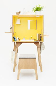 Koloro-desk by Torafu Architects  This desk by Japanese studio Torafu Architects looks like a doll's house, with little windows in the walls and a pendent lamp inside.The hatches can be left closed for greater privacy when you need to concentrate, or opened up and used as shelves.There's a round hole in the top to hold a plant pot and a matching stool includes storage space beneath the seat pad.