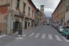 A street in Amatrice before the earthquake hit. The town's clock tower can be seen in the distance. Photograph: Google street view