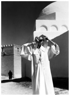 Natalie Paine wearing a coat by Grès  1950