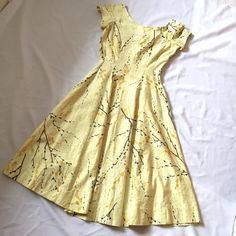Vintage 1960's Yellow Floral Day Dress S It's in good vintage condition with the exception of a small faint stain as shown in the top left of the last photo. Zips up the side. The dress is unlined and looks great with a small crinoline if you so choose. Pay close attention to the measurements since they may not fit within the standard measurements. 36 inch bust, 26 inch waist, 42.5 inches long. Keep in mind this is an older dress, so expect to see some wear. Vintage Dresses
