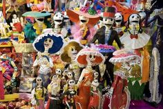 Catrinas of every hue, ready for Day of the Dead duty, beckon shoppers in Guanajuato's market. Guanajuato -- Catrinas of every hue, ready fo...