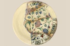 An example of a 16th c. glazed ceramic plate. Elaborate floral decoration of tulips, carnations, hyacinths and roses in a variety of colours (blues...