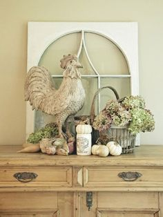 Rooster Vignette, old window lined with red ticking, basket with eggs decorated with red toile stamps,  on a pine foyer table with a French grain sack fabric table runner.