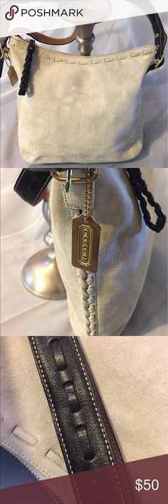 Coach suede crossbody handbag Coach. Mid sized slim bag suede cream color in excellent condition. On the back there is a small mark that I am researching how to get off. The last picture shows it. It is not really noticeable. But I want to be transparent. Coach Bags Crossbody Bags