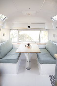 airstream dinette in calming blue and white // Living in a Beautifully Restored Vintage Airstream | cottagehillmag.com