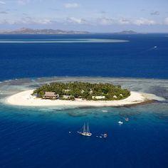 Stunning aerial views over Beachcomber Island  Credit Chris McLennan