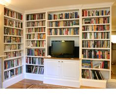 Built-in bookcase - dimensions vary - painted solid wood and ply