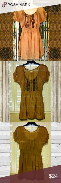 Semi-Sheer Brown Boho Tunic Top Lightweight semi-sheer goldish brown tunic top, brand is Mine for Anthropologie. Beautiful pre-loved condition!  Stretchy gathered waistband, ruffled cap sleeves, crochet trim, adjustable tie top. 65% cotton, 35% rayon, machine washable. 29 inches long, 17 inches across armpit to armpit.  #bohotop #bohotunic #hippietop #mine #anthro #Anthropologie Anthropologie Tops