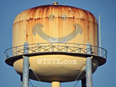 Smiley Face Water Tower which once stood just outside of Palestine at the old Calhoun packing plant.