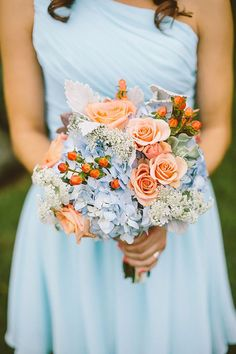 Bridesmaid in pastel blue dress and blue flowers