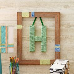 Colorful baker's twine and papier-mache come together to create a too-cute monogrammed Christmas gift: http://www.bhg.com/christmas/crafts/cute-craft-christmas-gifts/?socsrc=bhgpin120614framedmonogram&page=8