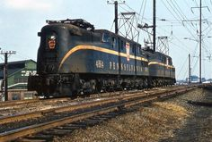 Pennsylvania Railroad GG1 #4864 and #4859 in Philadelphia, Pennsylvania sometime during the year 1966.