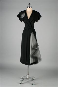Vintage 1940's black rayon dress with tulle swag.