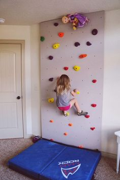Rock wall for kids play room- how fun! What a great way to keep the kids active, too!
