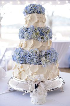 Ivory Wedding Cake With Blue Hydrangeas   Olexa's Cake and Catering   Heather Durham Photography https://www.theknot.com/marketplace/heather-durham-photography-birmingham-al-766517   Invision Events