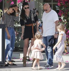 Girls' day! 34-year-old Alessandra went the classic route in a striped, long-sleeved top tucked and skinny jeans. She is pictured with LIly Aldridge, Lily's daughter Dixie, aged three, and her daughter Anja, aged seven