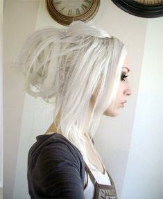 For some reason I love white hair. It makes the person who wears it look young and beautiful! Love the dread bun!