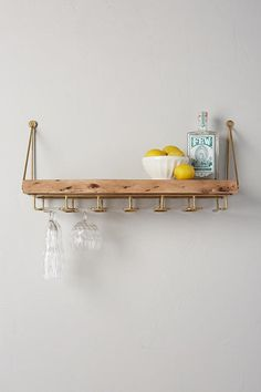 Anthropologie Live-Edge Bar Shelf Maximize your space by organizing spirits atop this smooth acacia wood shelf, and hanging stemware from its underside rack. Bar Shelves, Diy Hanging Shelves, Kitchen Shelves, Wood Shelves, Wall Bar Shelf, Live Edge Shelves, Hanging Bar, Wall Décor, Wall Art