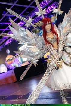 Erza Scarlet cosplay from Fairy Tail....that is A LOT of Mylar, amazing that she included the dancing swords as well
