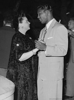 Judy Garland dancing with Sugar Ray Robinson. May, 1951.